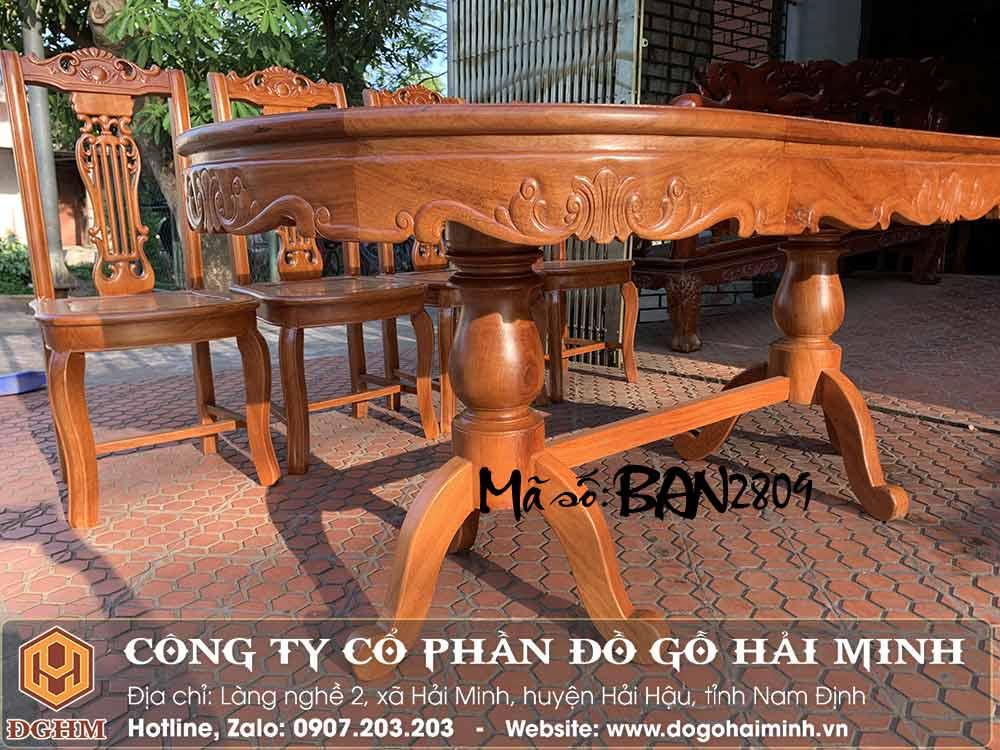 bàn ăn oval gỗ gõ